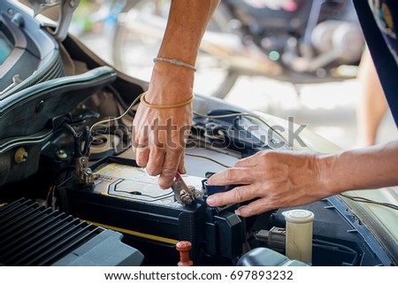 Engine engineer is replacing  car battery because car battery is depleted. concept car maintenance  #697893232