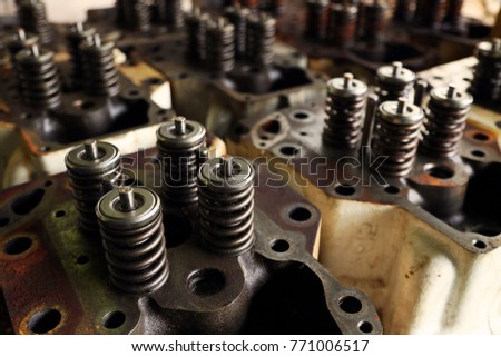engine exhaust valve and intake valve, spring valve of the engine and auto spare parts, machine parts damaged from work and the spring have been waited for repair by technician in the garage. #771006517