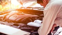 Engine maintenance, car manual reading, car care concepts.