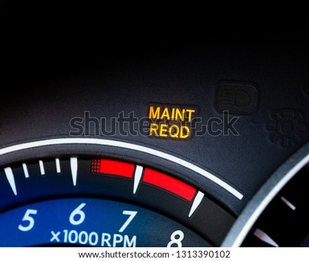 Engine maintenance or service light is on in car dashboard. Car dashboard cluster background #1313390102