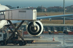 Engine of airplane in airport, preparing for take-off