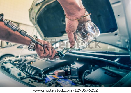 Engine oil change and engine maintenance #1290576232