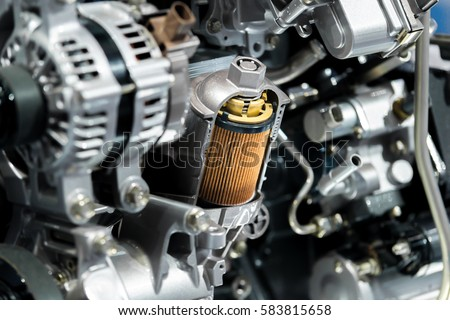 Engine oil filter cross section display inside machine motor in car