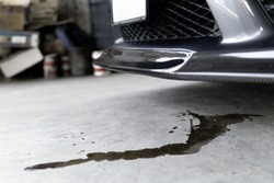 Engine oil stains of car Leak under the car when the car is park In the garage service floor photo concept for check and maintenance