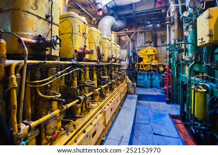 Engine room on a cargo boat ship, engine room on an oil platform, inside oil platform, inside ship