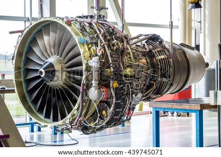 Engine\'s maintenance in huge industrial hall