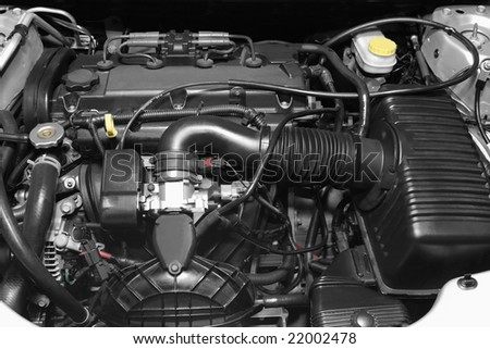 Engine under the hood of a car