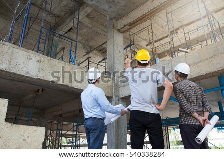Engineer and Architect working at Construction Site