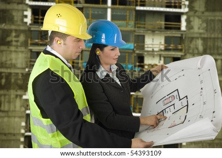 Engineer and client looking on project on the construction site