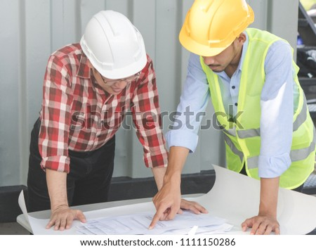 Free photos engineer working table plan and blueprint at building engineer and consultants planning construction process and look on blueprint on the table in site malvernweather Image collections