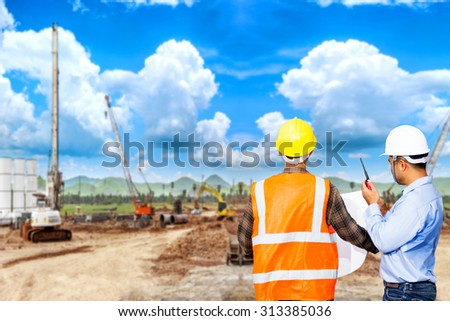 Engineer and foreman use radio communication for command working at construction site project