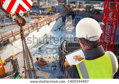 engineer architect Foreman on construction site with tablet computer