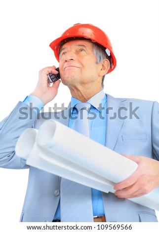 Engineer at the age of, talking on the phone. Isolated on a white background.