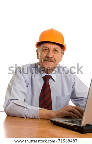 Engineer at the computer isolated on white background