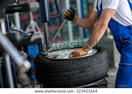engineer  balancing  car wheel on balancer in workshop Stock fotó ©