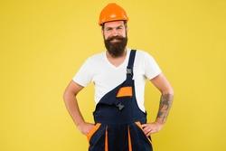 Engineer builder in uniform. Man builder hard hat. Renovating home opportunity to refresh expand and renew. Craftsman keep head safe in helmet. Building improvement and renovation. Brutal man builder.