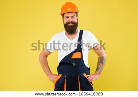 Engineer builder in uniform. Man builder hard hat. Renovating home opportunity to refresh expand and renew. Craftsman keep head safe in helmet. Building improvement and renovation. Brutal man builder.