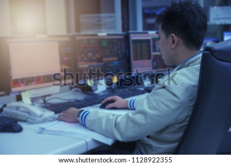 engineer center control room monitors process #1128922355