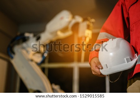 Engineer check welding robotics automatic arms machine. Programming robot with robotic arm