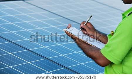 engineer checking solar power station