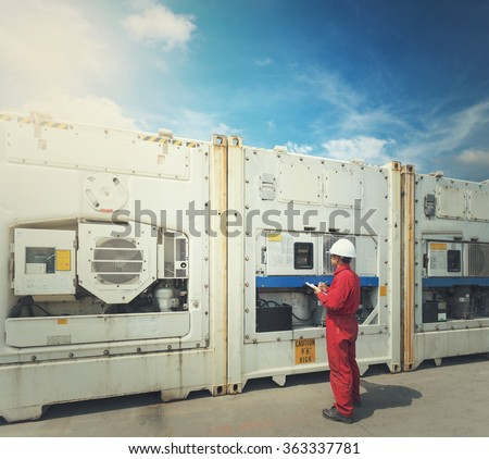 engineer checking temperature in front of Reefer Container box at  yard