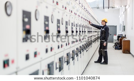 Engineer commissioning bay control unit. Engineering department. Medium voltage switchgear