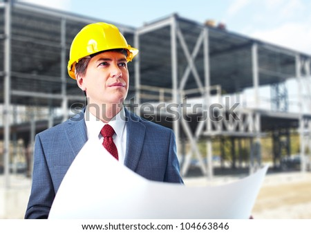 Engineer constructor with a project. Industrial worker.