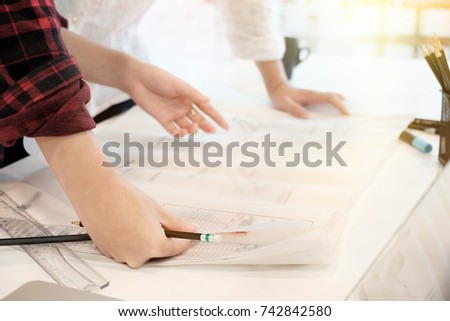 Engineer discussing meeting for architectural project working with partner and engineering tools on workplace Planning Design Draw Teamwork. #742842580