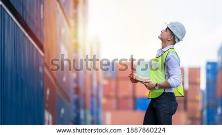 Engineer dock worker wear safety uniform check control loading freight cargo container use computer laptop at commercial dock warehouse, Global business logistic transportation cargo freight shipping. Photo stock ©