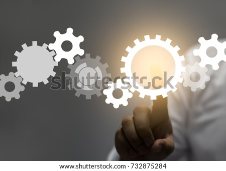 engineer draws a chain sprockets. Technology and industry concept