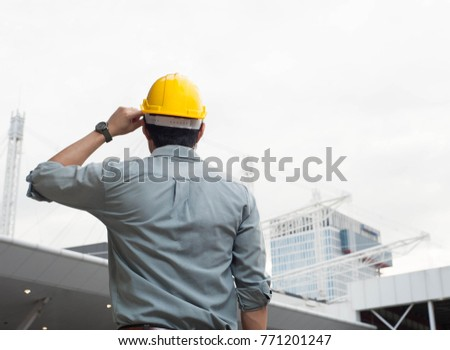 engineer,engineer man,engineer hat,Engineer is looking at the construction,smart engineer on day light background #771201247