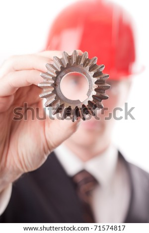 Engineer examine a gear