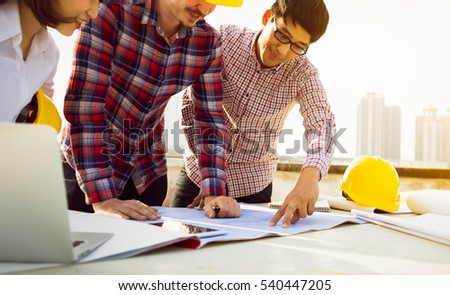 Engineer group and worker meeting, discussion with construction blueprint on site work stock photo