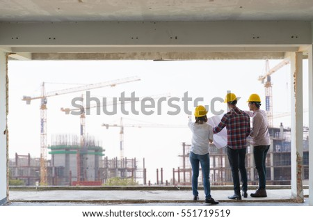 Engineer group and worker meeting, discussion with construction blueprint on site work and point finger to the site workplace