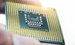 Engineer hand holding cpu chipset.