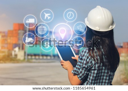 Engineer hand holding digital tablet with hologram on front container and import export background, Technology and Business transportation of international logistics concept