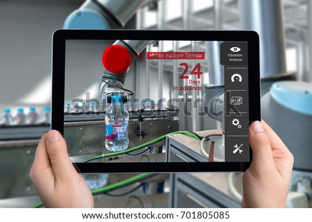 Engineer hand using tablet, automation robot arm machine in smart factory with tablet real time vibration analysis monitoring system application for check motor failure. Industry 4th sensor concept.
