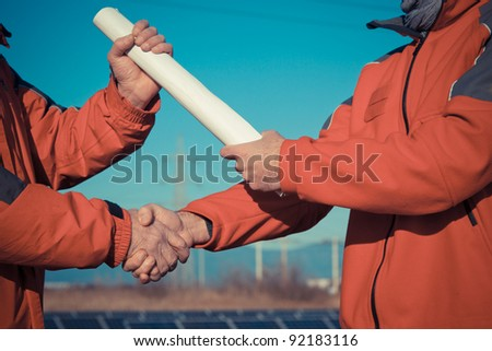 Engineer Handshake with Plans Delivery #92183116