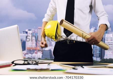 Free photos engineer hold security helmet and blueprint paper engineer hold security helmet and blueprint paper construction drawing plan near laptop computerarchitect working malvernweather Image collections