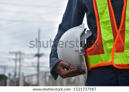 Engineer holding hard hat safety at work place and building development estate heavy architecture contractor, electrician occupation technical foreman,  professional use hardhat safety of supervisor