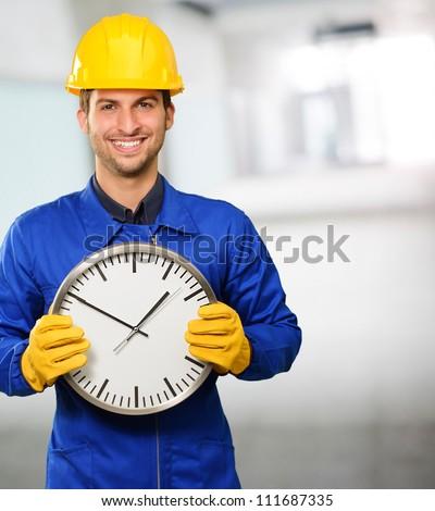 Engineer Holding Wall Clock, Indoor