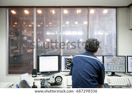 Engineer in control room.
