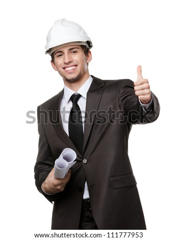 Engineer in white hard hat and keeping drafts thumbs up, isolated on white