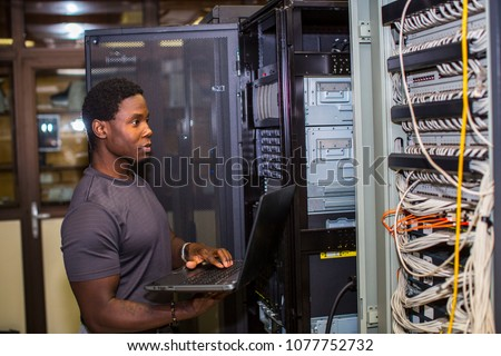 Engineer inspecting a rack #1077752732