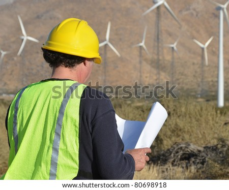 Engineer inspecting Site/Project Manager at the Wind Farm/Man working in the enviromental