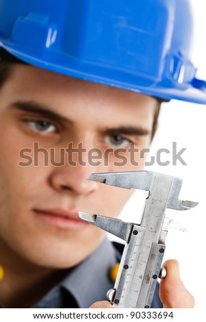Engineer looking at a caliper