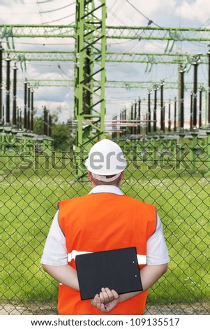 Engineer near the electricity substation