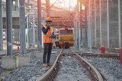 Engineer on railways. engineer train on the railway.Worker walk on railway. engineer railway concept.infrastructure,rails,engineer