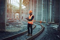 Engineer on railways. engineer train on the railway.Worker walk on railway. engineer  railway concept.