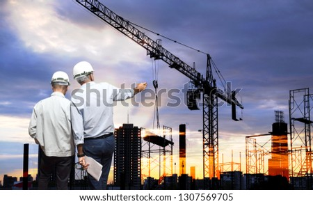 Engineer on site, they are working at building construction area.
